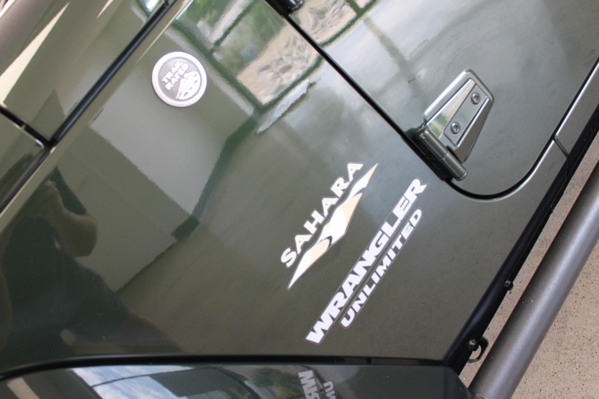 Used-2010-Jeep-Wrangler-Unlimited-Sahara-4X4-Ferrari