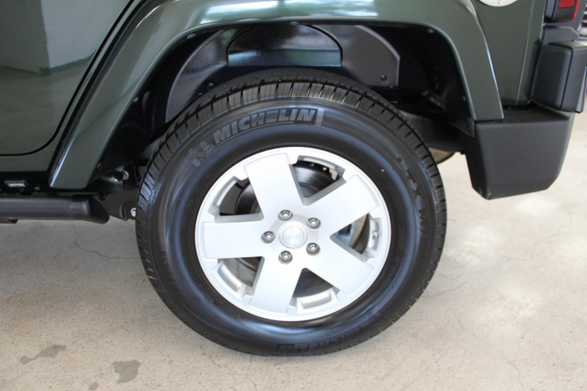 Used-2010-Jeep-Wrangler-Unlimited-Sahara-4X4-Jaguar