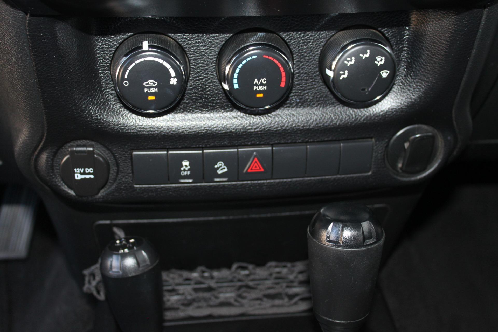 Used-2012-Jeep-Wrangler-Sport-4X4-Tesla