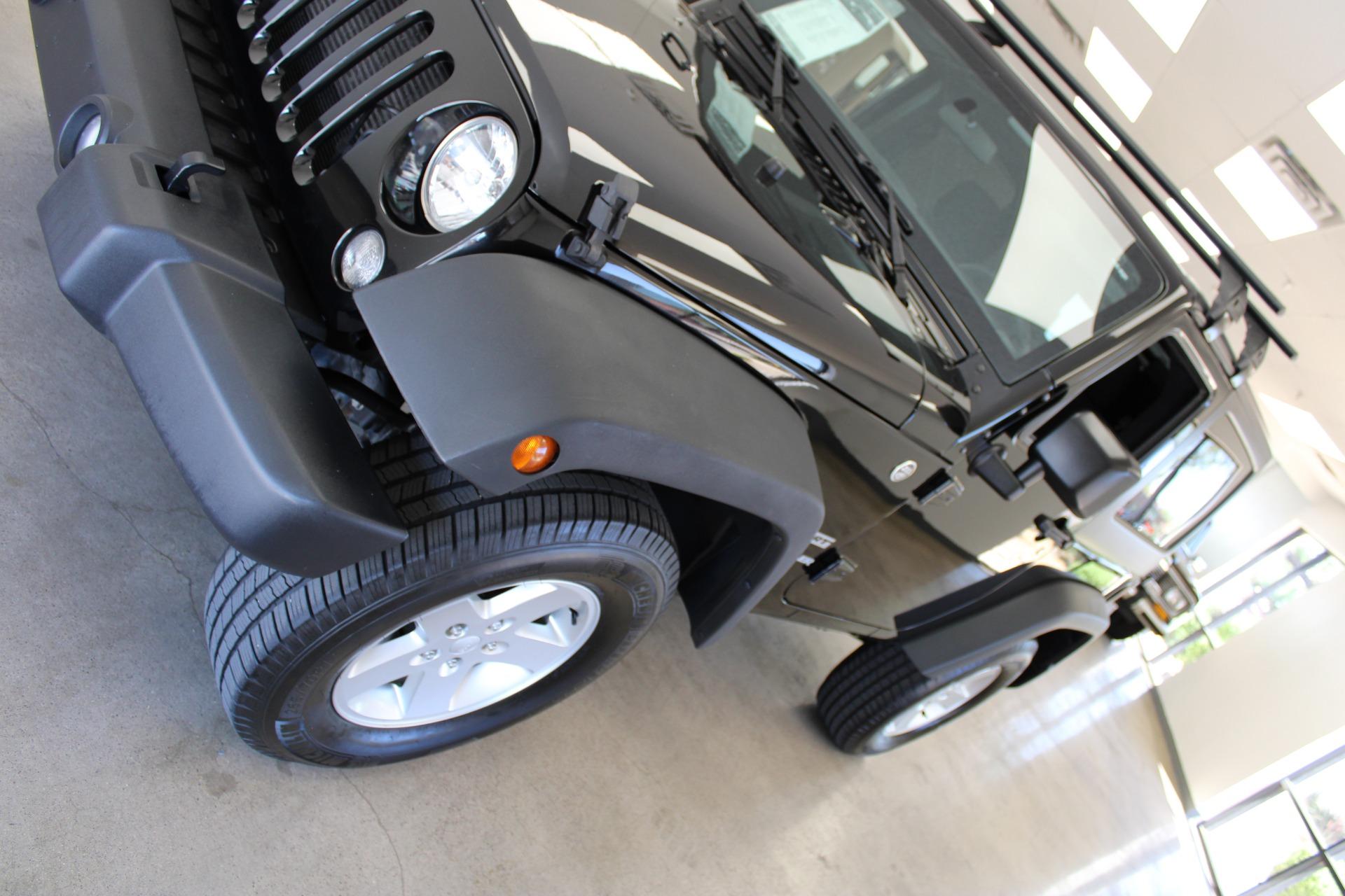 Used-2015-Jeep-Wrangler-Sport-Grand-Cherokee