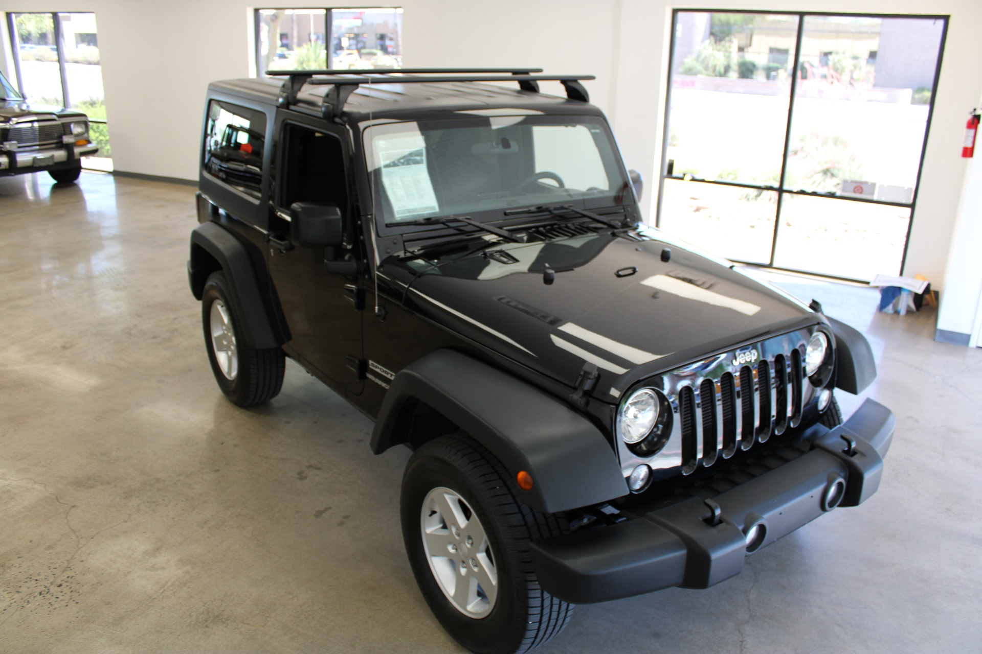 Used-2015-Jeep-Wrangler-Sport-LS430